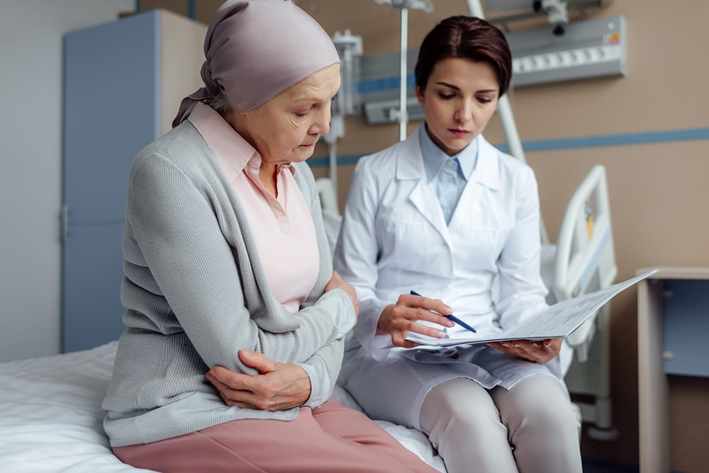 An atomic home healthcare worker goes over a clients recommended decision, discussing further options